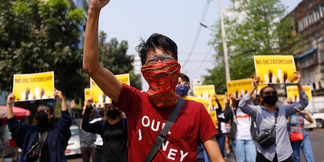 """Anti-coup protesters gesture during a march in Yangon, Burma, Friday, March 26, 2021. Protesters against last month's military takeover in Burma returned to the streets in large numbers Thursday, a day after staging a """"silence strike"""" in which people were urged to stay home and businesses to close for the day. (AP Photo)"""