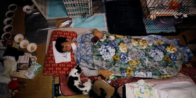 Kato, 57, has been taking care of dozens of cats in Fukushima for the last decade. (Reuters)