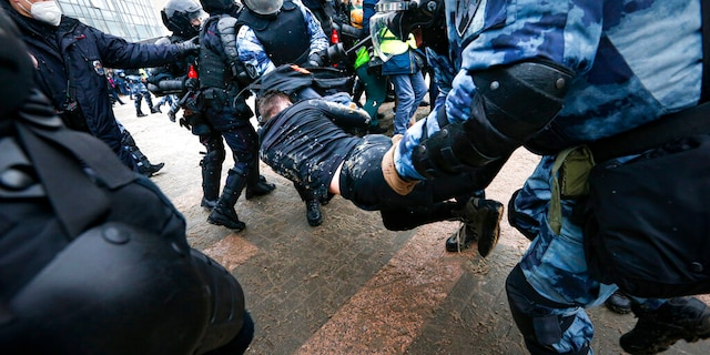 Police officers detain a man during a protest against the jailing of opposition leader Alexei Navalny in Moscow, Russia, on Jan. 31. (AP)