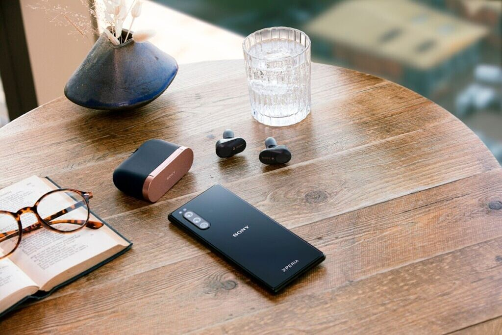 sony WF-1000XM3 earbuds on table with xperia phone