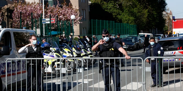 Police officers block the access with barriers next to the police station in Rambouillet, south west of Paris, Friday, April 23, 2021. (AP Photo/Michel Euler)