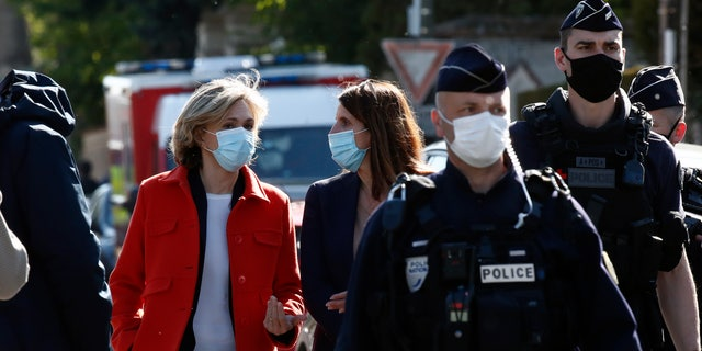 Head of the Ile de France regional council Valerie Pecresse, left, arrives at the Police station in Rambouillet, south west of Paris, Friday, April 23, 2021. (AP Photo/Michel Euler)