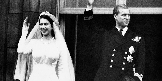 In this Nov. 20, 1947 file photo, Britain's Princess Elizabeth and her husband the Duke of Edinburgh wave to the crowds on their wedding day, from the balcony of Buckingham Palace in London.