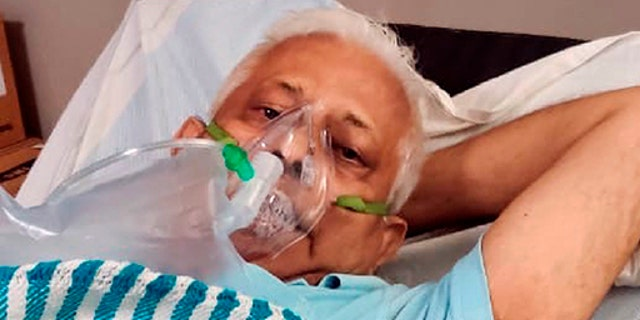In this photo provided by the Rev. Cedric Prakash, the Rev. Jerry Sequeira is given oxygen in Ahmedabad, India, during the country's second wave of the coronavirus pandemic. Sequeira died from COVID-19 on April 18, 2021.