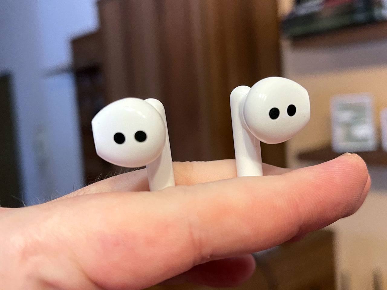 earbuds in hand