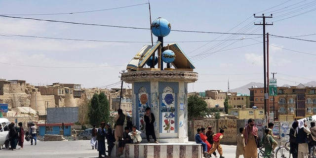 A Taliban flag flies at a square in the city of Ghazni, Afghanistan, after fighting between Taliban and Afghan security forces Thursday, Aug. 12, 2021. (AP Photo/Gulabuddin Amiri)