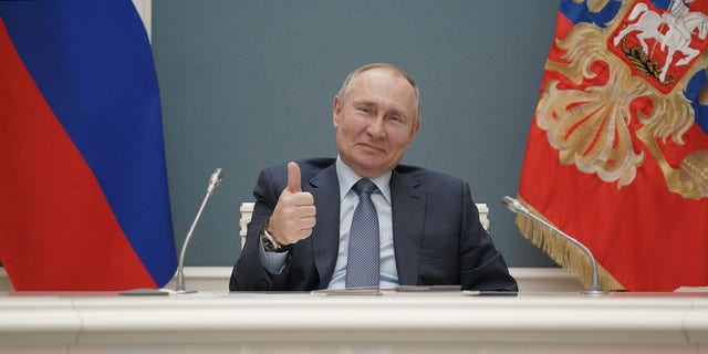 FILE PHOTO: Russian President Vladimir Putin gives a thumbs-up as he attends a foundation-laying ceremony for the third reactor of the Akkuyu nuclear plant in Turkey, via a video link in Moscow, Russia March 10, 2021. Sputnik/Alexei Druzhinin/Kremlin via REUTERS